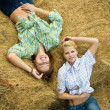 Girls  resting on hay - Stock Photo