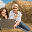 Girls with notebook in farm - Stock Photo