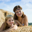 Stock Photo: Country girls laying on hay