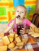 Little girl eating jam — Stock Photo