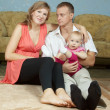 Parents with baby in home - Stock Photo