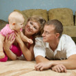 Parents with baby in home — Stock Photo #7598324
