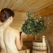 图库照片: Girl is steamed in sauna