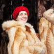 Woman chooses fur coat — Stock Photo #7599163