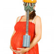 Pregnant woman in hardhat and gas-mask — Stock Photo #7599178
