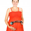 Royalty-Free Stock Photo: Pregnant woman with headphones on tummy