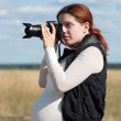 Royalty-Free Stock Photo: Pregnant woman taking photo