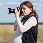 Pregnant woman taking photo — Stock Photo #7599246
