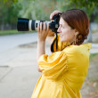 Pregnant woman with camera — Stock Photo #7599252