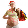 Pregnant woman with christmas gifts — Foto Stock
