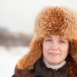 Girl in fur cap at wintry park — Stock Photo #7599316