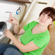 Woman doing laundry - Stock Photo