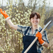 Female farmer gesturing welcom - Stock Photo