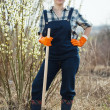 Foto Stock: Female farmer with spade in spring