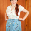 Woman shows handmade jeans — Stock Photo #7599411