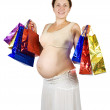 Стоковое фото: Pregnant womwith shopping bags
