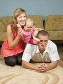 Happy parents with baby — Stock Photo