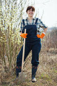 Female farmer with spade in spring — Stock Photo