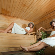 Foto Stock: Happy girl in sauna