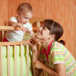 Happy mother plays with baby — Stock Photo
