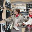 Stock Photo: Women shopping at shoe store