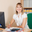 Businesswoman on her workplace in office — Stock Photo #7610723