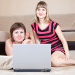 Women using laptop in home — Stock Photo