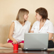 Girls talking on sofa — Stock Photo