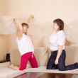 Happy girls fighting with pillows — Stock Photo