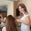 Hair stylist work on woman — Stock Photo