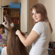 Hair stylist work on woman hair - Foto Stock