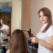 Female hairdresser working with  girl - Foto Stock