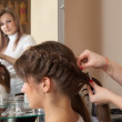 Hairdresser working with long-hair - Stock Photo