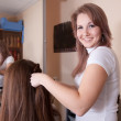 Hairdresser working with long-haired girl - Stock Photo
