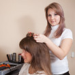 Hairdresser works on womhair — Stock Photo #7611388