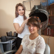 Hairdresser working with hair dryer - Foto Stock