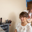 Female hair stylist working with girl - Foto Stock