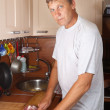 Man cooking meat — Stock Photo