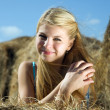 Country girl on hay — Stock Photo #7612186