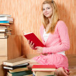 Girl with books on sofa - Foto Stock