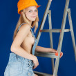 Stock Photo: Sexy girl on stepladder over blue