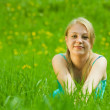 Girl relaxing outdoor in grass — Stockfoto