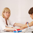 Nurse taking blood sample - Stock Photo