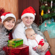 Family near Christmas tree - Foto Stock