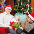 Happy family celebrating Christmas - Foto Stock