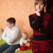 Stock Photo: Family of three having quarrel
