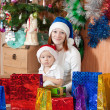 Mother and little son with Christmas gifts — ストック写真