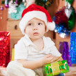 Boy  with  Christmas gift — Stock Photo #7613170