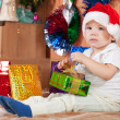 Stock Photo: Little boy with Christmas gift