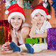 Mother and little son with Christmas gifts — Stock Photo #7613172